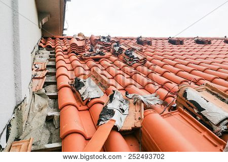 Old Moldy Roof Tile Being Replaced With New Tiles