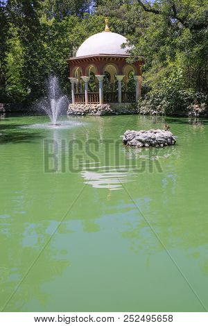 Seville, Spain - July 7th, 2018: Pavilion Of King Alfonso Xii Of Spain, Remains Of The Gardens Of Th
