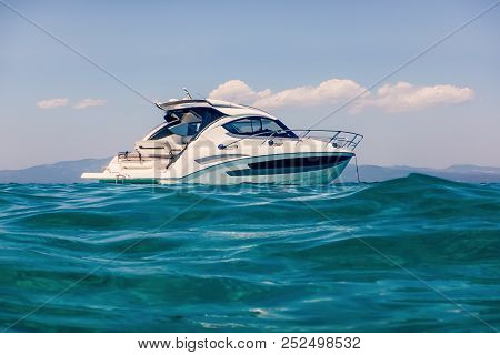 Motor Boat Floating On Clear Turquoise Water