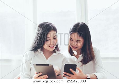 Woman Using Smartphone And Tablet On The Internet Lifestyle. Concept Of Future And Trend Internet Fo