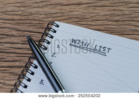 Wish List Concept, Pen On White Paper Note Pad With Handwritten Headline As Wish List And Numbers Li