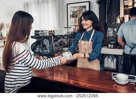 Barista Served Hot Coffee Cup To Customer With Smile Face At Counter Bar In Cafe Restaurant,coffee S