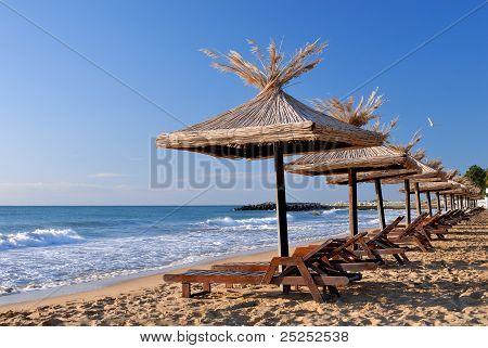 Sunchairs And Umbrellas On The Beach