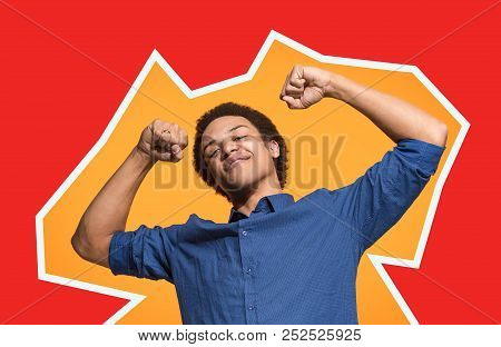 I Won. Winning Success Happy Man Celebrating Being A Winner. Dynamic Image Of Afro Male Model On Gre