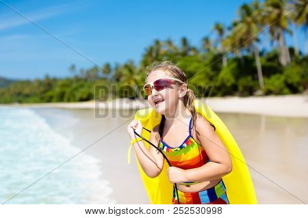 Kids Sail On Yacht In Sea. Child Sailing On Boat. Little Boy And Girl In Safe Life Jackets Travel On