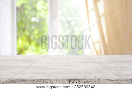 Wooden Table Top On Blurred Window Background For Product Display