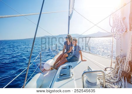 Boy With His Mother On Board Of Sailing Yacht On Summer Cruise. Travel Adventure, Yachting With Chil