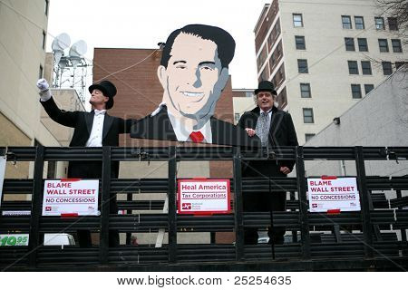 MADISON,WI - FEB 19: Opponents hold a image of Gov Scott Walker, at a march protesting his attack on public workers on Feb 19, 2011 in Madison, WI.  The Wisconsin drive to recall Walker starts Nov 15.