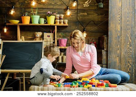 Mothers Day Concept. Mother And Little Son Play With Toy Bricks On Mothers Day. Mothers Day Games. H