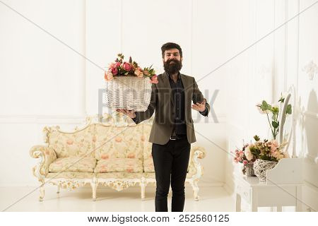 Florist Concept. Happy Florist Man Hold Basket With Fresh Flowers. Florist Salon. Florist In Flower