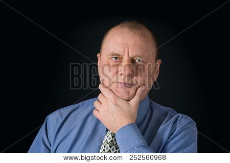 Nice Portrait Of Mature Office Clerk Against Black Background