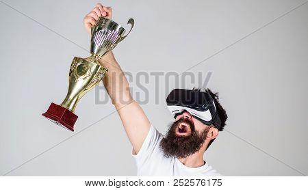 Championship Online. Man Bearded Hipster Vr Headset Holds Golden Goblet. Man Winner Virtual Competit