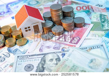 Real Estate Or Property Investment. Home Mortgage Loan Rate. Saving Money For Retirement Concept. Co