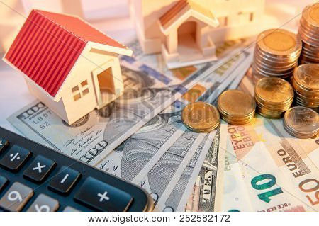 Real Estate Development Or Property Investment Concept. Home Mortgage Loan Rate. Coin Stack On Inter