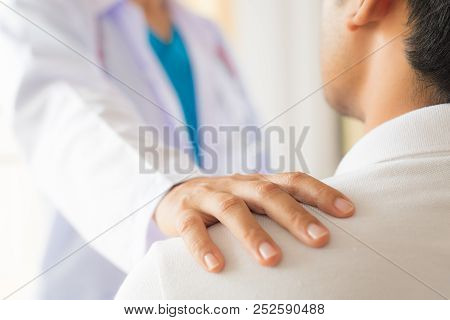 Female Doctor Put Hand On Patient Shoulder For Encouragement And Discussion. Medicine And Health Car