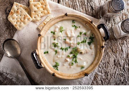 A Delicious Creamy White Fish Chowder With Haddock, Cod, Potato, And Onion Garnished With Parsley An