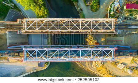 Top-down Drone View Of The Railway Bridge With A Train Over The Matsesta River In Sunny Summer Day,