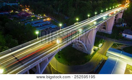 Drone View Of The Illuminated Matsesta Viaduct And Mountainsides With Dense Forest At Twilight, Soch