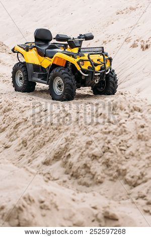 Modern Yellow All-terrain Vehicle Standing In Desert