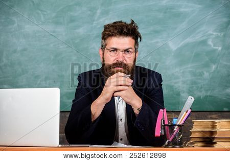 Teacher Concentrated Bearded Mature Schoolmaster Listening With Attention. Pay Attention To Details.