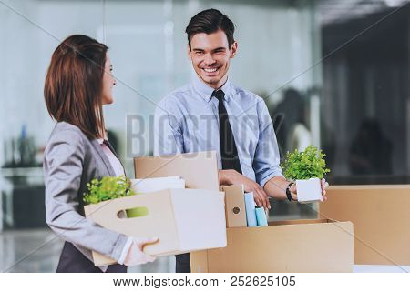 Workers With Carton Boxes. Smiling In Office. Packed Stuff For Moving. Business Concept. People In F