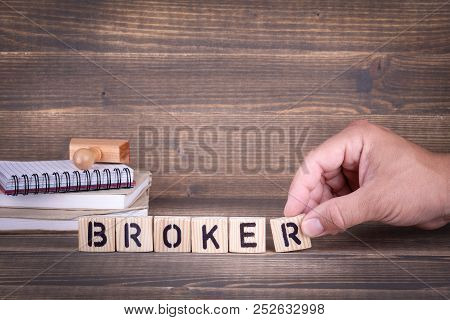 Broker. Wooden Letters On The Office Desk, Informative And Communication Background