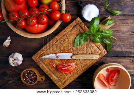 Ingredients For Tomato Sauce On A Cutting Board