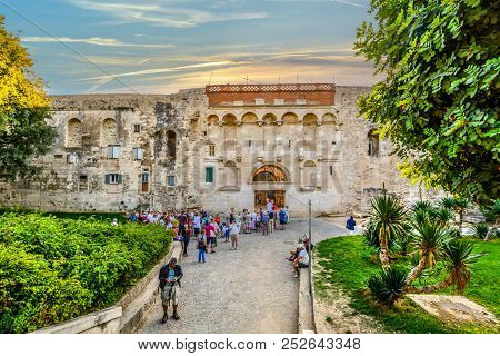 Split, Croatia - October 2 2017: Tourists Gather In Tour Groups Outside The Ancient Golden Gate To T