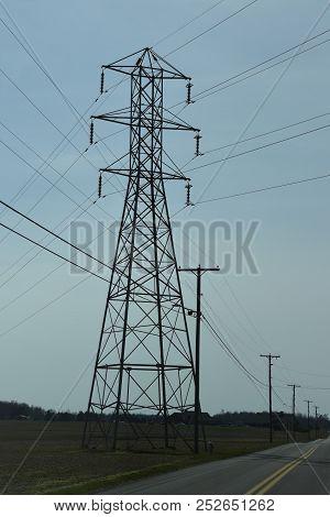 A 380 Kv Transmission Power Line Above A 25 Kv Distribution Power Line Under A Clear Blue Sky