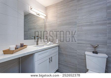 Grey Interior Of A New Bathroom In Apartment Complex