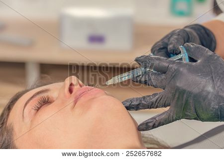 Beauty injections Close Up. Lip filler injection. poster