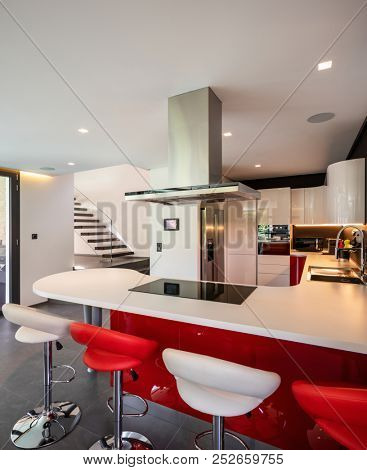 Red kitchen detail in modern villa. Nobody inside