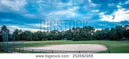 An Open Baseball Field In The Country