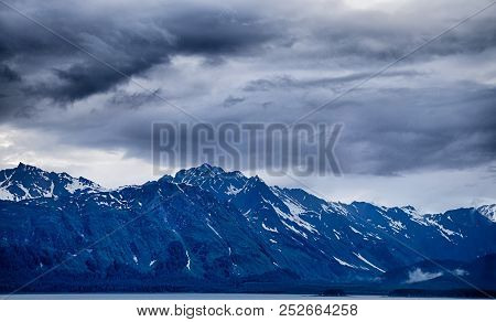 Beautiful Sunset And Cloudsy Landscape In Alaska Mountains