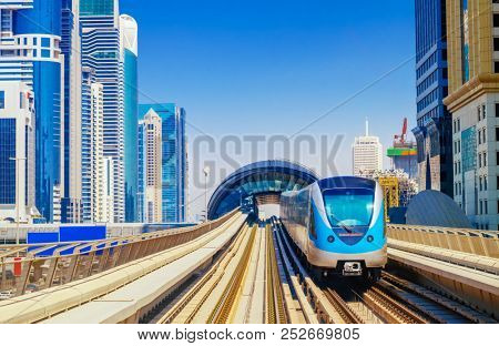City Metro Train in Sunlight on the Outdoor Railway. Modern City Transport Background.