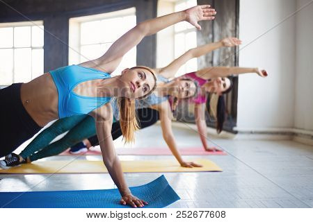 Leisure, Sport, Fitness, Yoga Class, Relaxation, Balance, Flexibility. Fit Women Practicing Yoga In