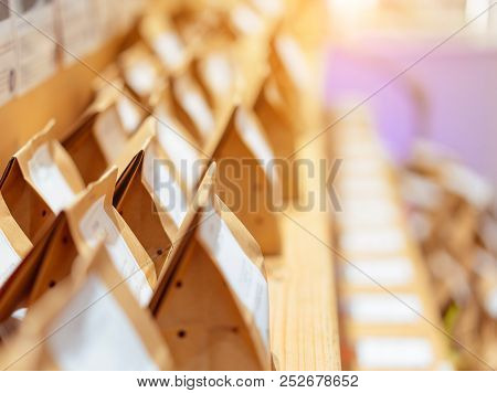 Brown Paper Food Bag Packages On Wooden Shelf