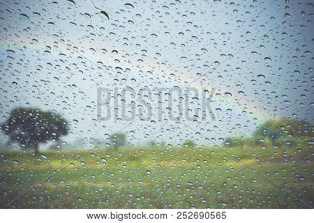 Raindrop On Windshield With Blurry Rainbow Background,vintage Style.