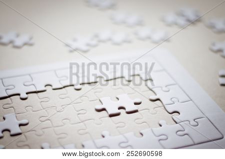 Jigsaw Puzzle On Brown Background Table Desk.