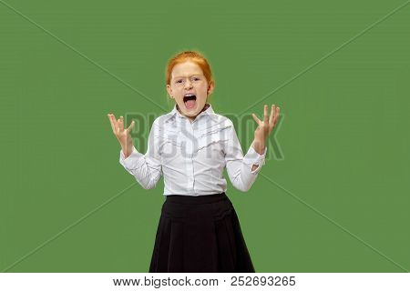 Screaming, Hate, Rage. Crying Emotional Angry Teen Girl Screaming On Green Studio Background. Emotio