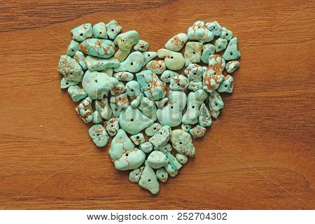 Turquoise Stones On A Background Of Natural Wood Black Walnut. Blue Color Stone. Collection Of Miner