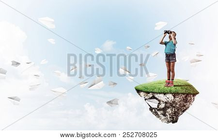 Concept Of Careless Happy Childhood With Girl Looking In Binocul