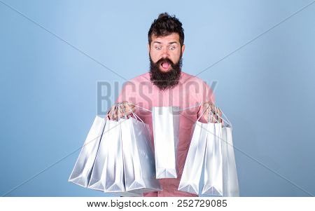 Hipster On Shocked Face Shopping Addicted Or Shopaholic. Guy Shopping On Sales Season With Discounts