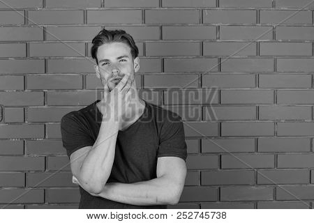 Body Language And Confidence Concept. Macho With Thoughtful And Confident Face Holds Hand Hear Chin