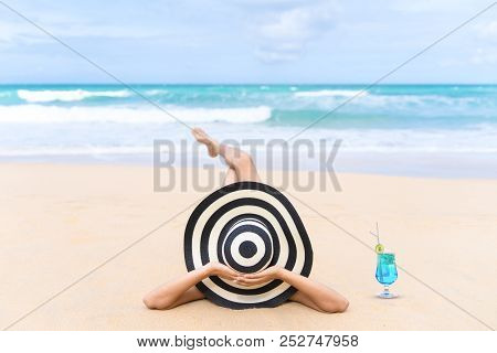 Young Fashion Woman Relax On The Beach. Happy Island Lifestyle. White Sand, Blue Cloudy Sky And Crys