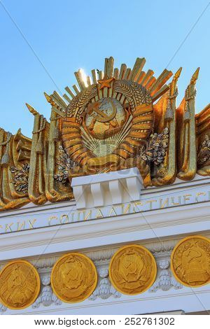 Moscow, Russia - August 01, 2018: Gilded Coat Of Arms Of Soviet Union With Coats Of Arms Of Union Re