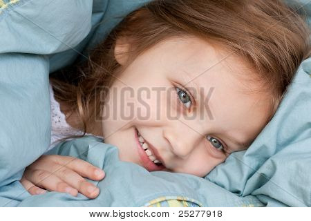 happy child under the sheets