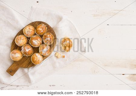 Top View On Woooden Board With Himemade Vanilla Muffins On White Background. Baking At Home