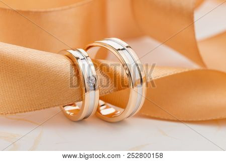 Two-tone Wedding Rings With Ribbon. Rose Gold And Silver Rings