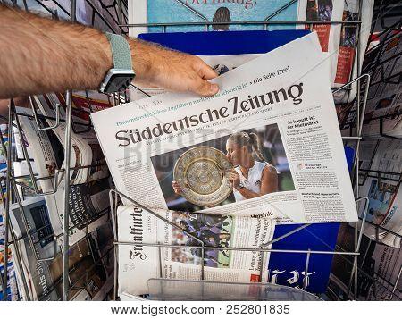 Paris, France - Jul 16, 2018: Man Buying  Newspaper Announcing Angelique Kerber Winning Tennis Title